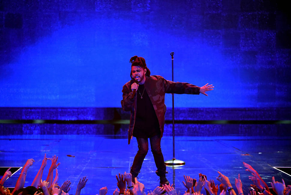 LOS ANGELES, CA - AUGUST 30: Recording artist The Weeknd performs onstage during the 2015 MTV Video Music Awards at Microsoft Theater on August 30, 2015 in Los Angeles, California. (Photo by Kevin Winter/MTV1415/Getty Images For MTV)