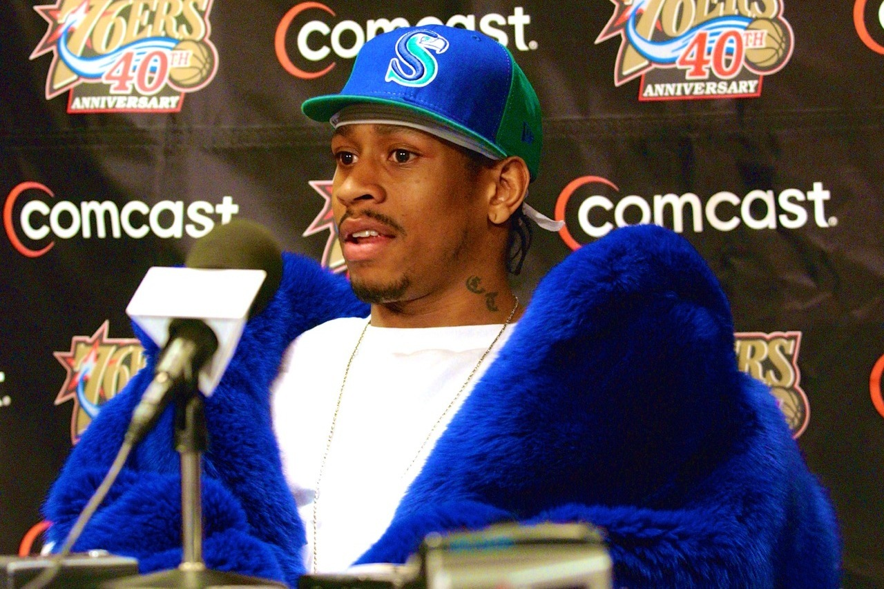 PHILADELPHIA - DECEMBER 4: Guard Allen Iverson #3 of the Philadelphia 76ers speaks at the post game press conference wearing a Seattle Seahawks cap after the 76ers defeated the Boston Celtics at the First Union Center on December 4, 2002 in Philadelphia, Pennsylvania. The 76ers won 99-93. NOTE TO USER: User expressly acknowledges and agrees that, by downloading and or using this photograph, User is consenting to the terms and conditions of the Getty Images License Agreement. Mandatory copyright notice: Copyright NBAE 2002 (Photo by Jesse D. Garrabrant/ NBAE/ Getty Images)
